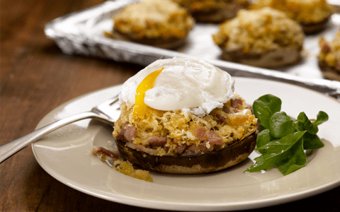 Baked Stuffed Flat Mushrooms Topped with a Poached Egg and Cheese